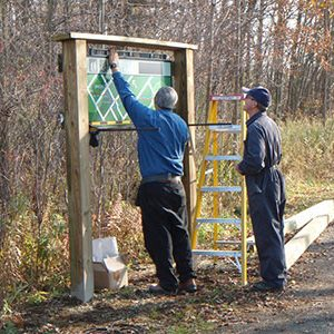 Volunteers erecting new signs