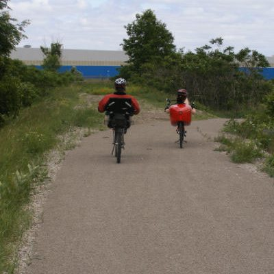 Two cyclists travelling east on Delhi Rail Trail