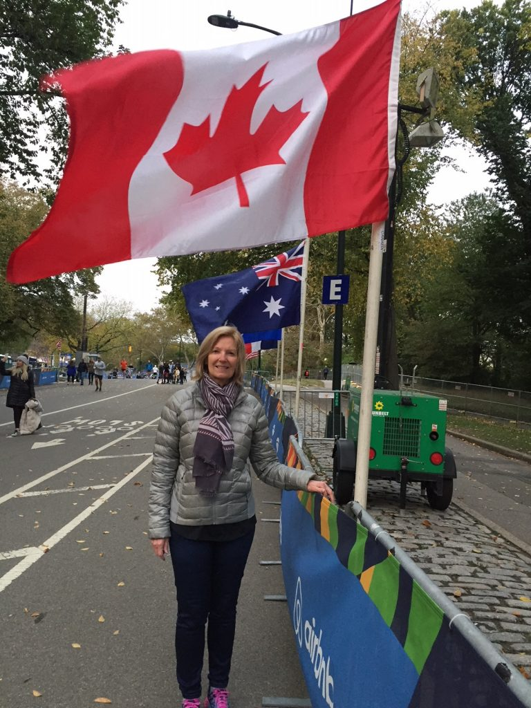 Ingrid Eaker pictured in front of the Canadian flag parade of nations